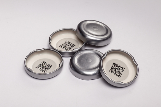 Under-the-cap QR codes  Crown Closures came up with an idiotic idea. To enhance consumer interaction Crown incorporates the QR codes by using the billboard space under the cap. In other words on the interior of a metal closure used on food and beverage applications thanks to FDA-approved inks and printing technologies. And Crown Closures argues that brands can benefit from an additional platform to engage consumers in future purchases or encourage them to try different products from the same brand. The idiocy is that the consumer has to buy the product first, as the QR code can't be read and thus experienced on the shelf. Crown thinks that the non-visible QR code will encourage the consumer to make the purchase, because he must be curious to see the code.