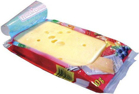 The new Flexbox peel and reseal package from Formost Packaging Machines, Inc., is made on a Fuji-Formost horizontal flow wrapper. This flow wrap package for cheese blocks and other items allows total access to the product without touching it. Simply peel the label back and you can slice your cheese and then reseal the package. The special side gussets enable the pack to retain its shape without collapsing.