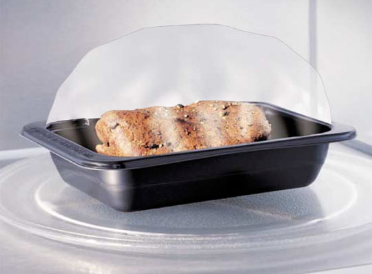 During heating the film expands to form a bubble, and then self-vents and relaxes over the food