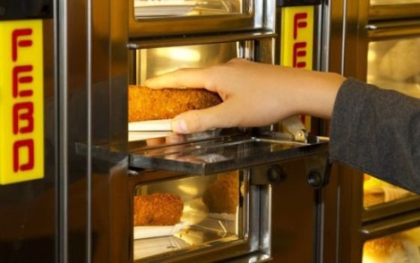 A Febo hot snack vending machine in Holland. In general a Febo cluster of vending machines has a (small) kitchen at the back, where employees fresly prepare the snacks and mini-meals, continuously refilling the open spaces in the vending machines.