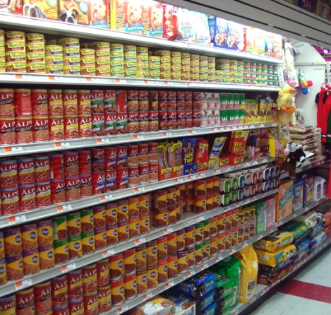 Australian grocery store shelf with wet dog food tins
